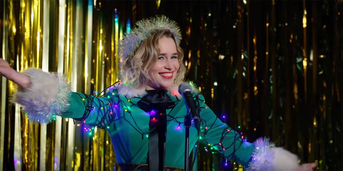 Emilia Clarke covered in Christmas lights in Last Christmas