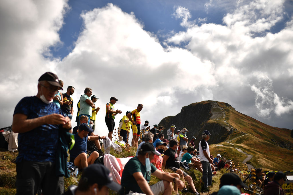 Spectators wait for the riders near the finish line in Puy Mary during the 13th stage of the 107th edition of the Tour de France cycling race, 191 km between Chatel-Guyon and Puy Mary, on September 11, 2020. (Photo by Anne-Christine POUJOULAT / AFP) (Photo by ANNE-CHRISTINE POUJOULAT / AFP)