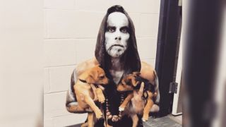 Nergal from Behemoth with puppies