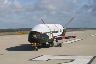 A U.S. Air Force X-37B space plane is seen on a runway at the Vandenberg Air Force Base in California in this taxi test image from June 2009.