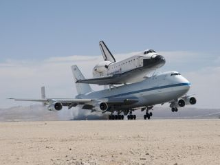 NASA's Shuttle Carrier Aircraft with the space shuttle Endeavour securely mounted on top touches down at Edwards Air Force Base after third leg of its four-segment final ferry flight from the Kennedy Space Center in Florida to Los Angeles International Ai