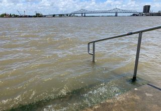 The Mississippi River laps at the stairs on a protective levee in New Orleans as Tropical Storm Barry approaches on July 11, 2019.