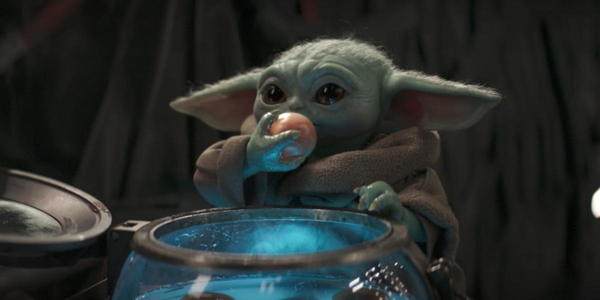 The mandalorian baby yoda eating frog lady egg
