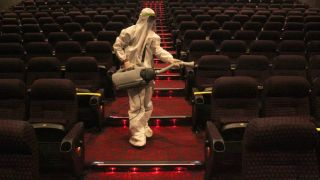 A cinema is disinfected during the COVID-19 pandemic.
