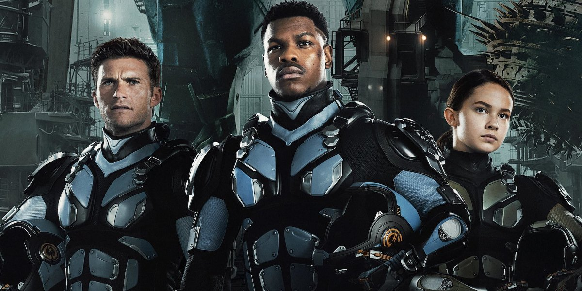 Pacific Rim Uprising Scott Eastwood John Boyega and Cailee Spaeny stand proudly in their Jaeger suit