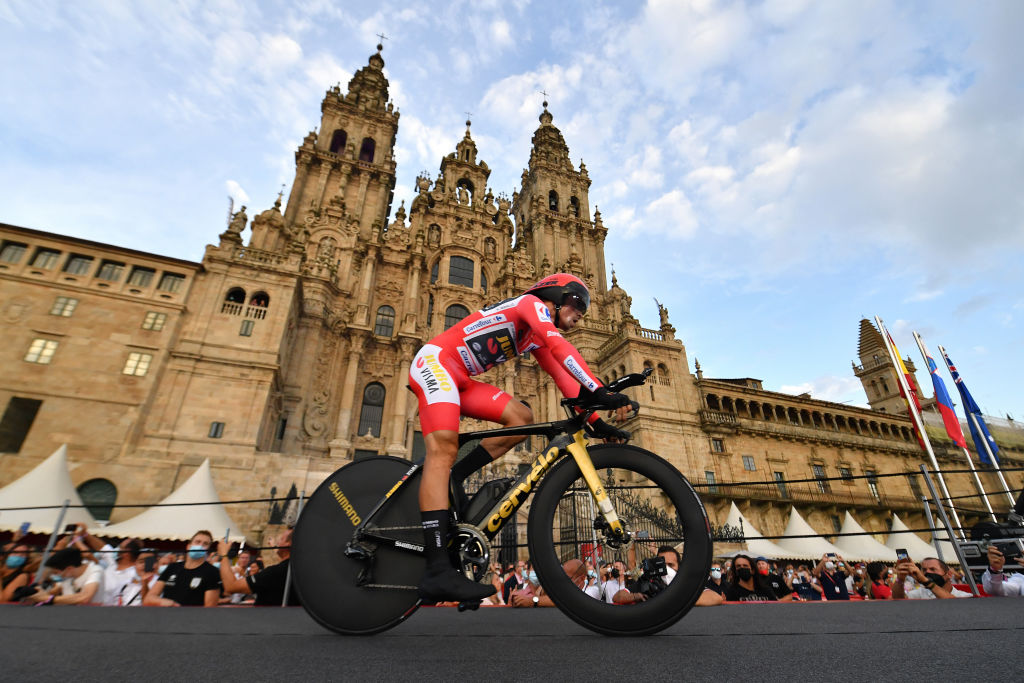 SANTIAGO DE COMPOSTELA SPAIN SEPTEMBER 05 Primoz Roglic of Slovenia and Team Jumbo Visma red leader jersey competes in the Plaza del Obradoiro with the Cathedral in the background during the 76th Tour of Spain 2021 Stage 21 a 338 km Individual Time Trial stage from Padrn to Santiago de Compostela lavuelta LaVuelta21 ITT on September 05 2021 in Santiago de Compostela Spain Photo by Stuart FranklinGetty Images