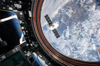 SpaceX Dragon outside ISS cupola module