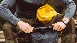 best dry bag: a man holding a dry bag