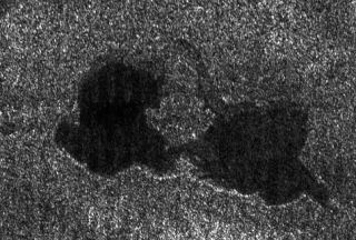 An image from NASA's Cassini probe, taken Sept. 23, 2006, shows a pair of hydrocarbon lakes on Titan.