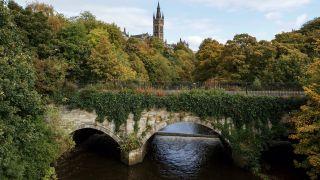 University of Glasgow behind lush trees, Glasgow, Scotland