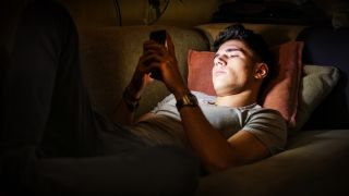 Man using phone irresponsibly at night
