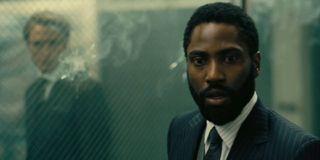 Tenet John David Washington is shocked with Robert Pattinson in the background