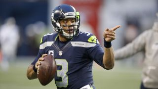 Seattle Seahawks quarterback Russell Wilson directs traffic.