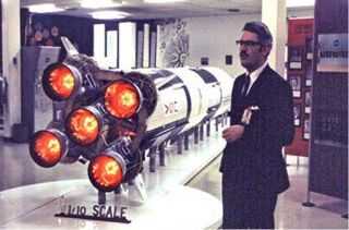 Jesco von Puttkamer with the Saturn V rocket booster model