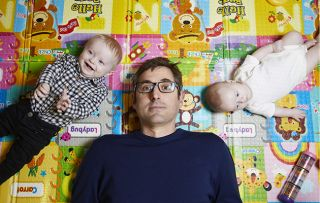 Louis Theroux with two babies for his new BBC2 doc Mothers on the Edge