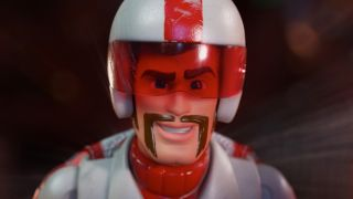 CGI depiction of smiling, moustachioed man in helmet