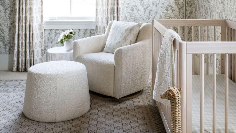 Studio McGee nursery with boucle armchair and crib