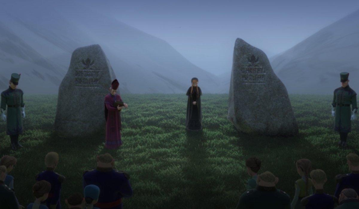 Frozen II King Agnarr and Queen Iduna's funeral, with Anna standing between headstones