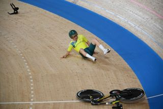 Alex Porter of Australia crashed in the men's Team Pursuit qualifying round after a bike failure