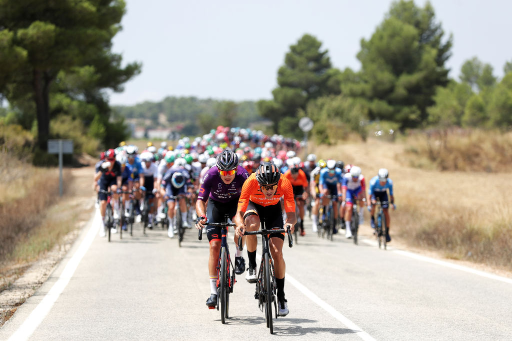 ALTO DE LA MONTAA DE CULLERA SPAIN AUGUST 19 LR Jetse Bol of Netherlands and Team Burgos BH and Joan Bou Company of Spain and Team Euskaltel Euskadi attack during the 76th Tour of Spain 2021 Stage 6 a 1583km stage from Requena to Alto de la Montaa de Cullera 184m lavuelta LaVuelta21 on August 19 2021 in Alto de la Montaa de Cullera Spain Photo by Gonzalo Arroyo MorenoGetty Images