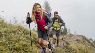 how to use trekking poles: hikers ascending with poles