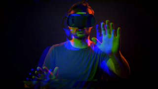 A person in a VR headset experiencing a terrifying game