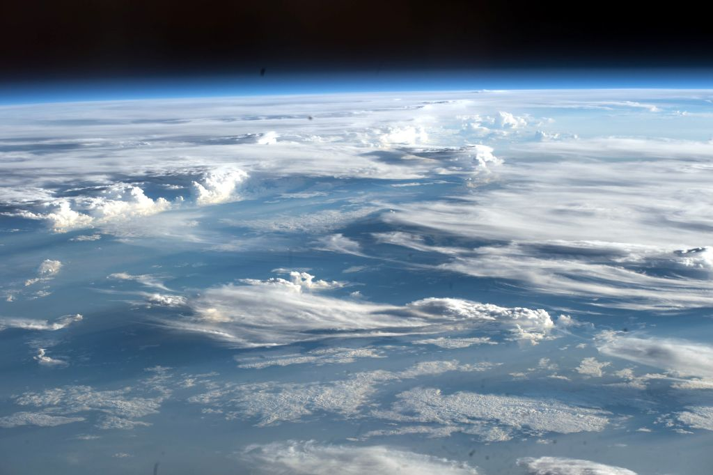 Earth's atmosphere is full of microbes. Could they help us find life on other worlds?