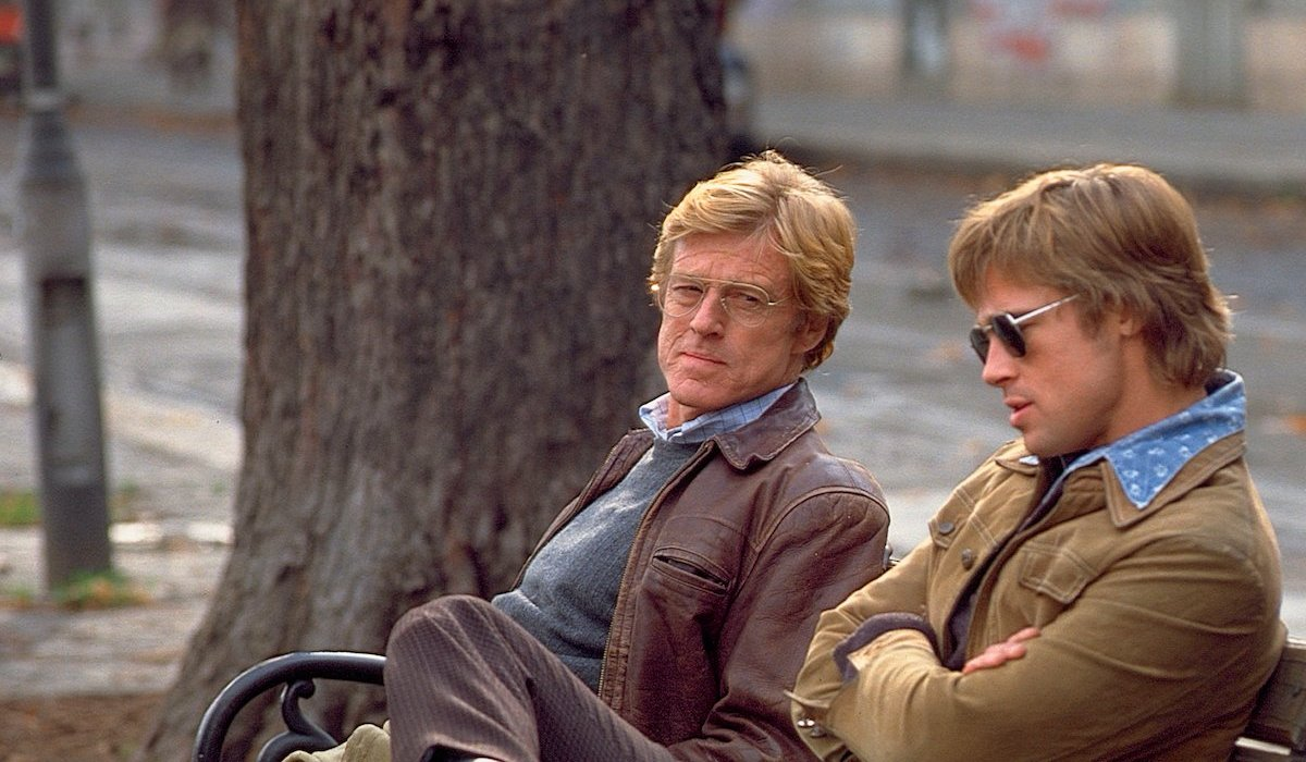 Spy Game Robert Redford on a bench with Brad Pitt