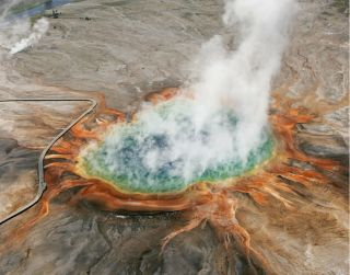 The concentric colors of Yellowstone's Grand Prismatic hot spring can be seen from above.