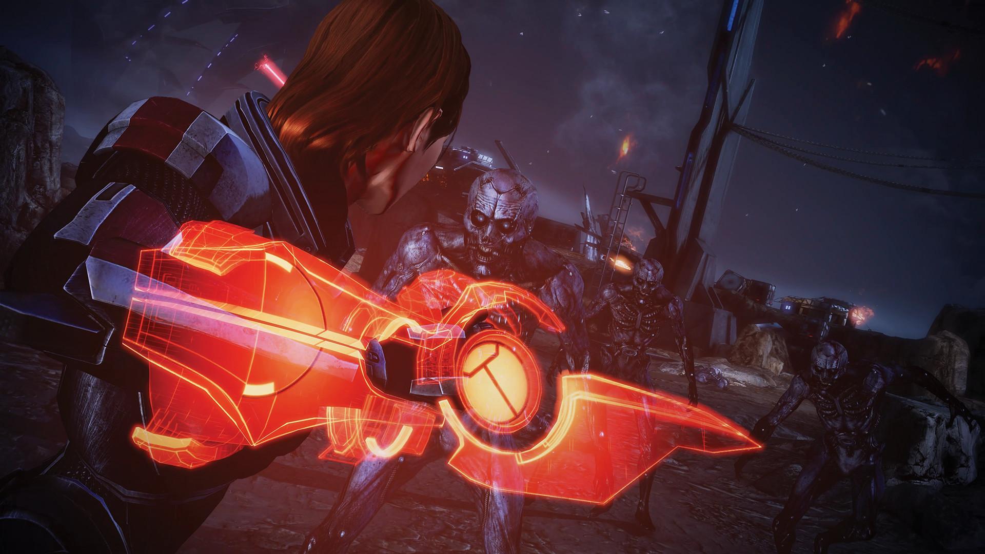 Commander Shepherd in Mass Effect Legendary Edition battling an enemy