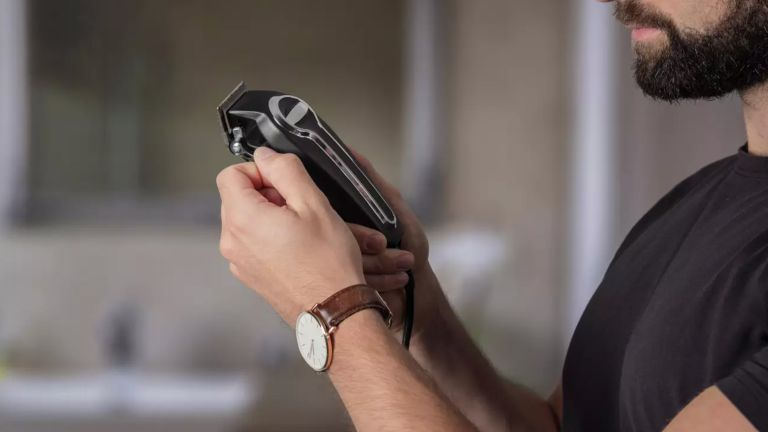 The best hair clippers, Wahl Elite Pro High Performance Haircutting Kit 79602-017X in man's hand