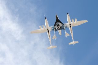 WhiteKnightTwo/SpaceShipTwo flies over New Mexico's Spaceport America.