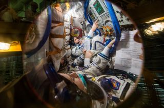 NASA astronaut Kate Rubins and Roscosmos cosmonauts Sergey Kud-Sverchkov and Sergey Ryzhikov are the three astronauts set to launch Oct. 14 to the International Space Station as part of Expedition 64. Here the astronauts can be seen during a fit check inside the Soyuz MS-17 spacecraft at the Baikonur Cosmodrome in Kazakhstan.