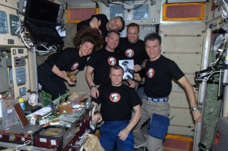 An International Space Station crew celebrated Yuri's Night, the anniversary of the first time a human flew in space on April 12, 1961, with dinner and a movie — and posing with a photo of the celebration's namesake, Yuri Gagarin.