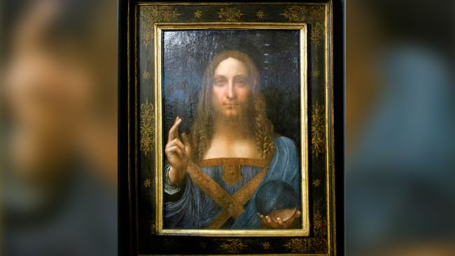 Leonardo da Vinci's 'Salvator Mundi' painting, shown here after being unveiled in Hong Kong on Oct. 13, 2017, has a dramatic past.