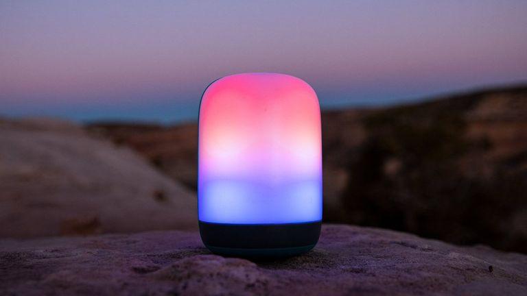 Biolite AlpenGlown lantern on a rock by the sea
