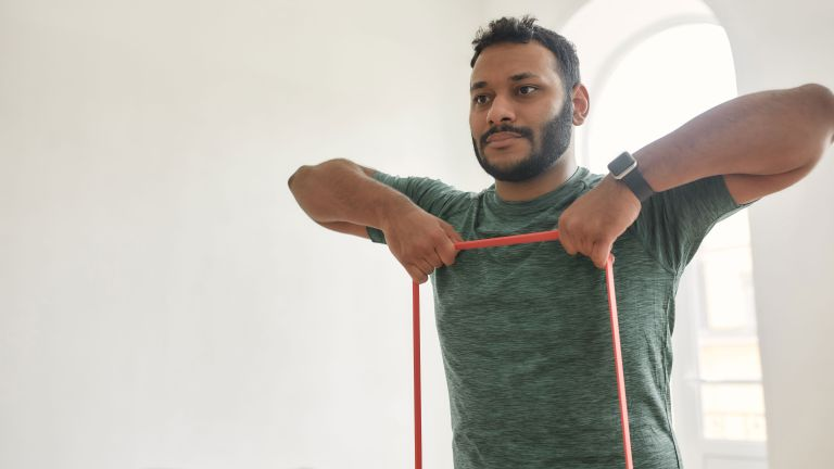 Man doing a chest workout with resistance bands