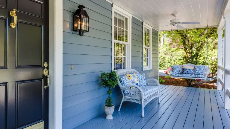 Front porch ideas showing a covered porch with bench and hanging bench seat