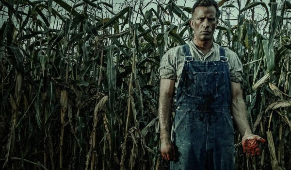 1922 Thomas Jane stands in the corn with bloodied hands
