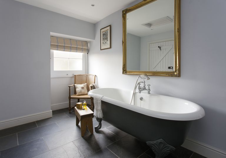 mouldy smell in the bathroom: freestanding bath in farmhouse bathroom