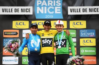 Winner Colombias Egan Bernal C celebrates his overall leader yellow jersey on the podium with second placed Colombias Nairo Quintana L and third placed Polands Michal Kwiatkowski wearing the best sprinters green jersey at the end of the 110km 8th and last stage of the 77th ParisNice cycling race stage between Nice and Nice on March 17 2019 Photo by AnneChristine POUJOULAT AFP Photo credit should read ANNECHRISTINE POUJOULATAFP via Getty Images