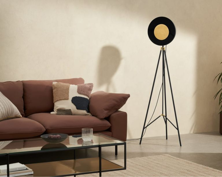 Made sale Ward Tripod Floor Lamp in living room beside pink sofa with cushions and black metal coffee table