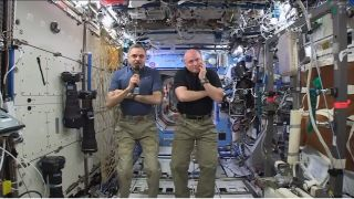 Mikhail Kornienko and Scott Kelly speak to press in the International Space Station.