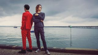 A photograph of Steven Wilson and Aviv Geffen on a pier