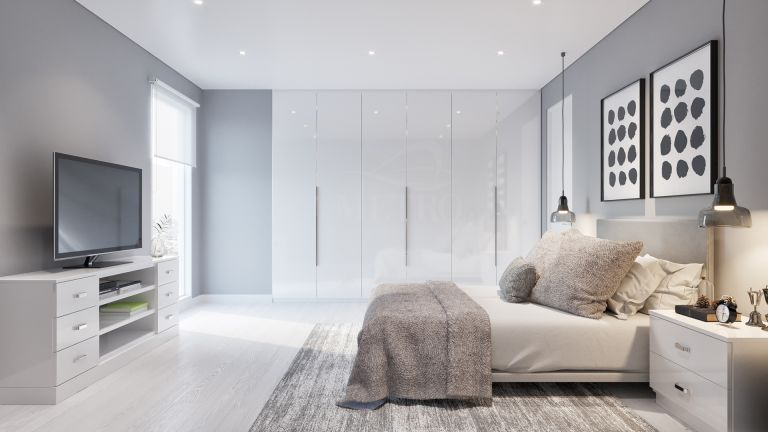 bedroom with bespoke built in wardrobes perfect for optimising space by metro wardrobes
