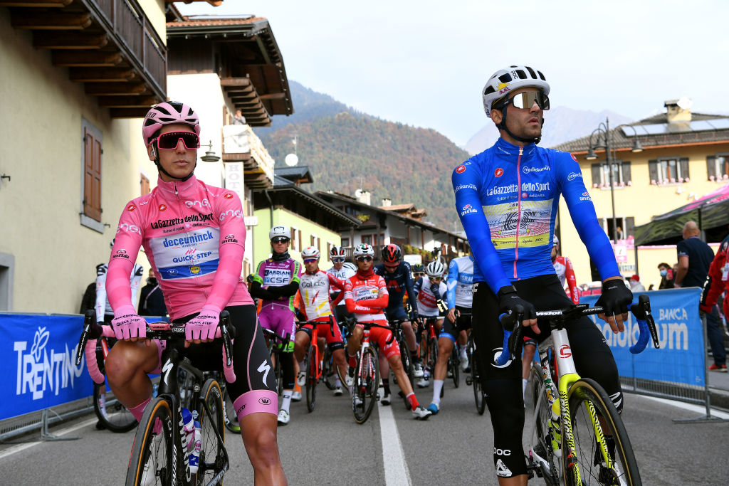 LAGHI DI CANCANO ITALY OCTOBER 22 Start Joao Almeida of Portugal and Team Deceuninck QuickStep Pink Leader Jersey Ruben Guerreiro of Portugal and Team EF Pro Cycling Blue Mountain Jersey during the 103rd Giro dItalia 2020 Stage 18 a 207km stage from Pinzolo to Laghi di Cancano Parco Nazionale dello Stelvio 1945m girodiitalia Giro on October 22 2020 in Laghi di Cancano Italy Photo by Tim de WaeleGetty Images