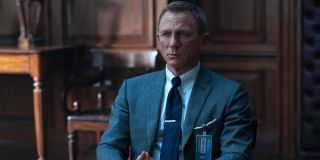 Daniel Craig sits stoically in M's office in No Time To Die.