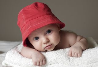 A cute baby in a red hat