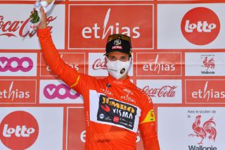 HERON BELGIUM JULY 18 Dylan Groenewegen of Netherlands and Team Jumbo Visma Red Leader Jersey celebrates at podium during the 42nd Tour de Wallonie 2021 Stage 1 a 1857km stage from Genappe to Hron 195m tourdewallonie grandprixdewallonie on July 18 2021 in Heron Belgium Photo by Luc ClaessenGetty Images