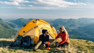 best 2-person tent: A couple camping in a 2-person tent